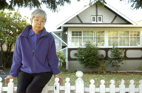 Joy Kogawa in front of her childhood home in Marpole