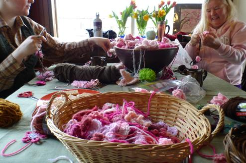 Knitters and crocheters made more than 500 blossoms in all shapes, sizes and shades of pink.