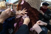 All hands on deck to attach blossoms to the yarn bark.