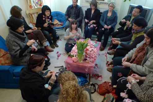 Former Kogawa House writer-in-residence Nancy Lee reads aloud while crafters work on garlands during one of the knit-ins organized by Prain and Moore.