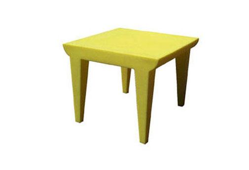 The pale yellow Bubble Club table designed by Philippe Starck for Kartell is both fun and functional