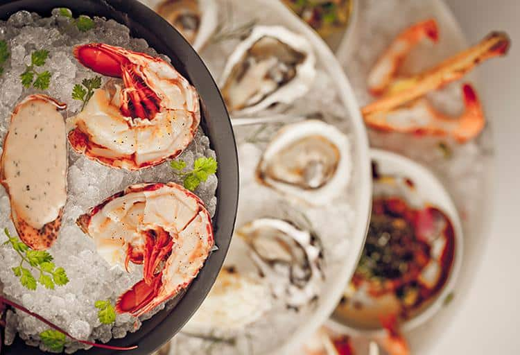 Throw on a bib and dig into mouth-watering seafood towers fit for a king