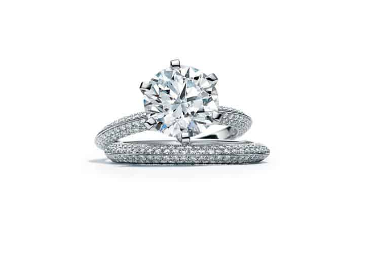 The 130th Anniversary Diamond Pavé Tiffany® Setting in Platinum with the Diamond Pavé Tiffany® Setting Band Ring, $3,118,000 and $16,900