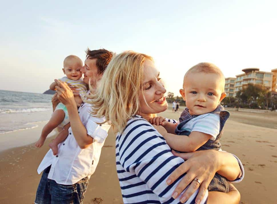 mom dad baby infants twins traveling beach travel vacation holiday