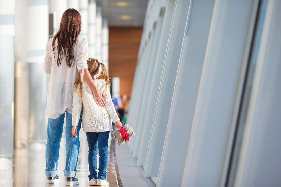 mom travel child together airport