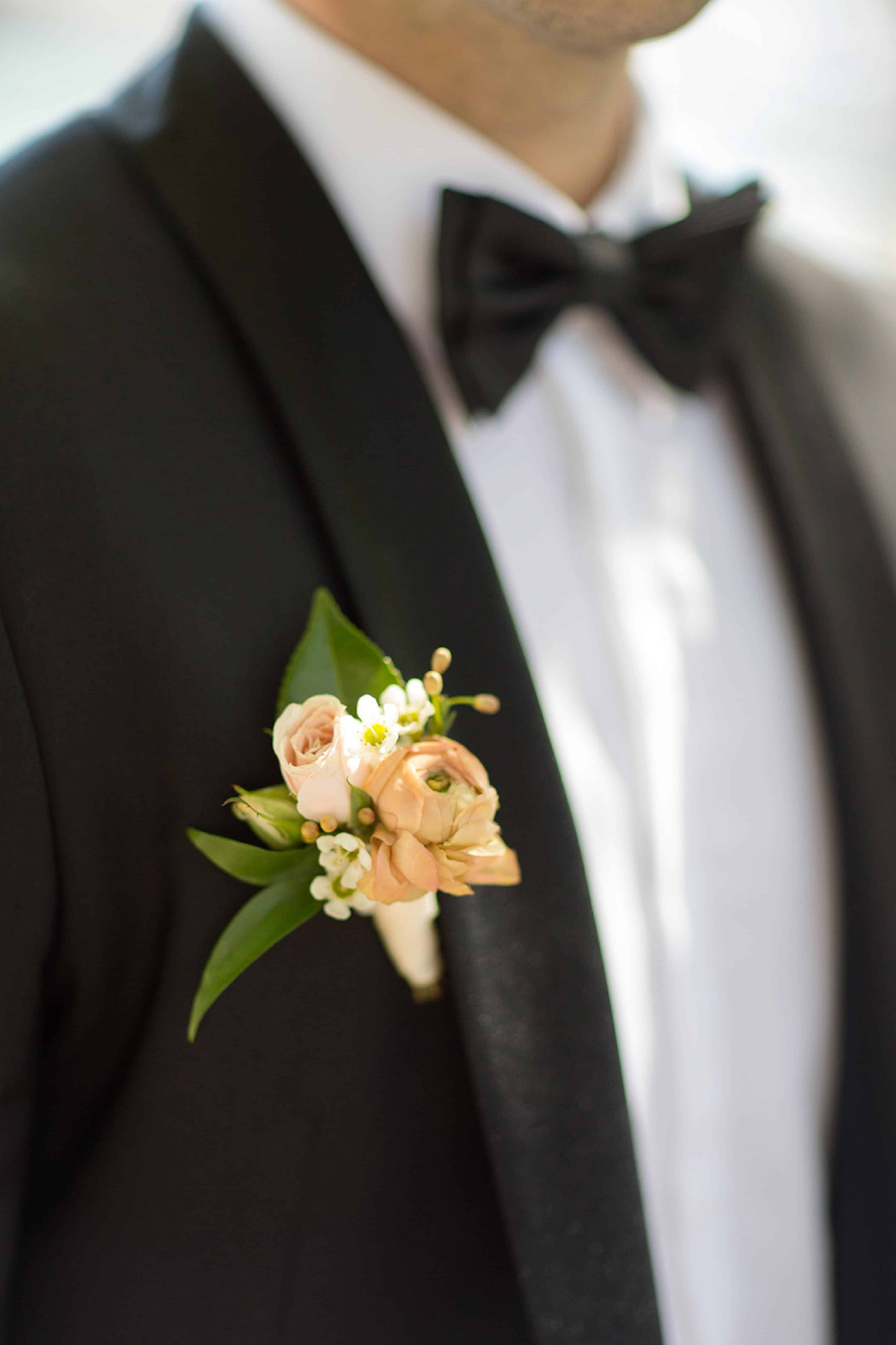Peach boutonnière by Celsia Florist