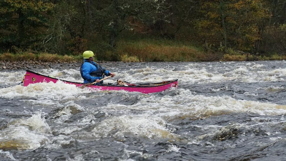 River Surfing a Canoe