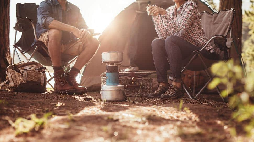 camping couple cooking butane element food hot chocolate