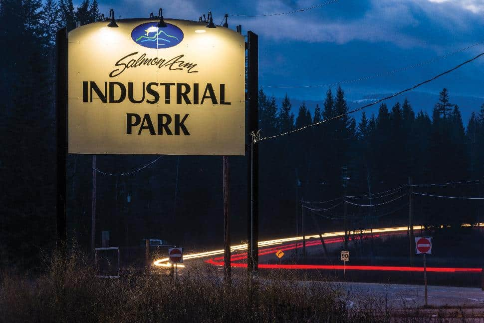 The sign for the Salmon Arm industrial park, lit up after dark