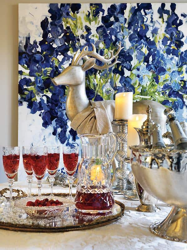 Make a seasonally themed cocktail With the white and silver backdrop, a pretty cranberry and champagne cocktail (top) pops as part of the decor (and your guests will love it).