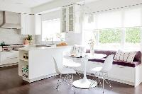 Divine Dining | The new kitchen design loses the island and includes a peninsula instead, creating a more efficient workspace. Everything went whiter and brighter.