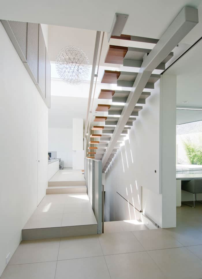This home's staircases bring a lightness to the home that keeps the vibe airy and open. Photo by Matt McLeod.