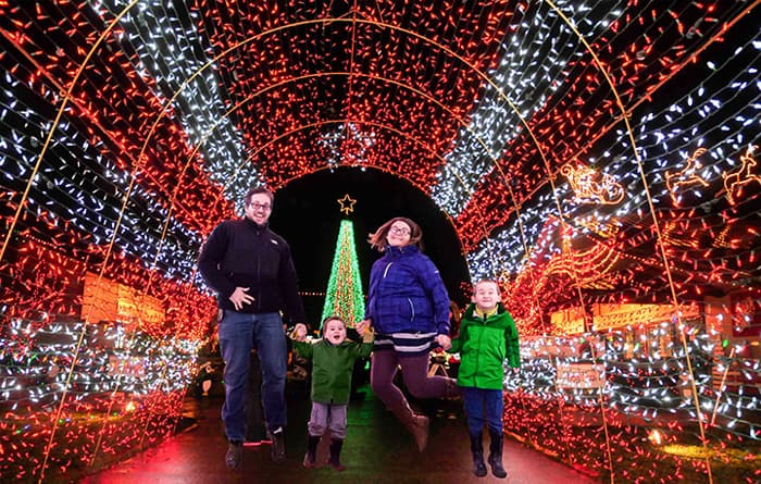 Family-Jumping-in-Light-Tunnel-Warm-Beach-Lights-of-Christmas-EDITED.jpg