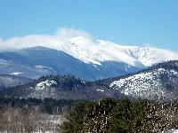 High winds blow snow off the peak of Mount Washington