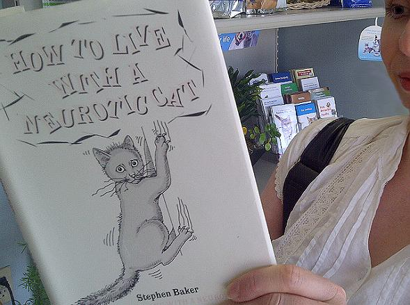 Me browsing a book at Derry Road Animal Hospital