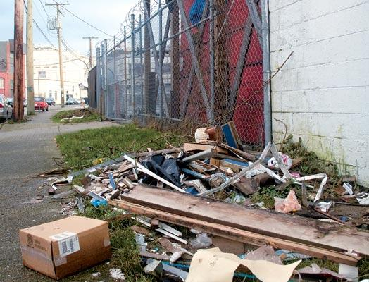 Discarded refuse is a common sight along Strathcona's abandoned alleyways.