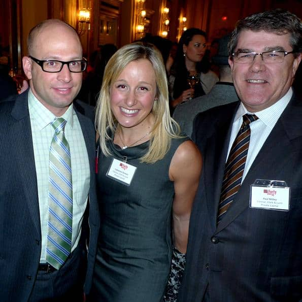 Catherine Dorazio and Paul Milley (l) of Connor Clarke Lunn Private Capital cheer on founder and CIO Jeffrey Guise as he accepts his award.