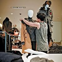 Visual stylist Bobbi Irons dresses a mannequin at Holt Renfrew in downtown Vancouver.