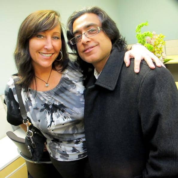 Diane Dubocq of Meta Response Group and Aj Jamani mingle while touring the new office space.