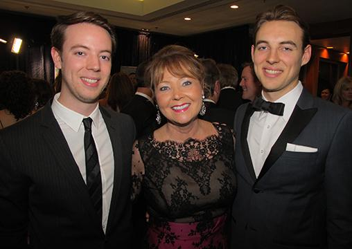 Chair of the 26th annual Crystal Ball, Diane Norton (m), with sons Justin (l) and Kyle.