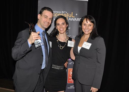 Best Company award winners from ReStoring Data Inc., Noam and IIana Kenig, are presented the award by the director of marketing from Telus, Leigh Tynan.