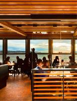 Rain or shine, diners can enjoy the scenic views indoors. But this building even finds a way to make use of Vancouver's wet and dreary winters. Rainwater is collected in a cistern and used for irrigation, and the green roof is used to grow herbs to flavou