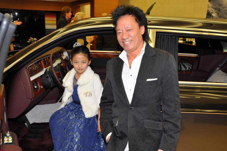Andy Chu from FMA Entertainment joins the youngest guest by the Rolls-Royce.