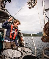 Leo Pointer pulls in nets to sample plankton from the water column