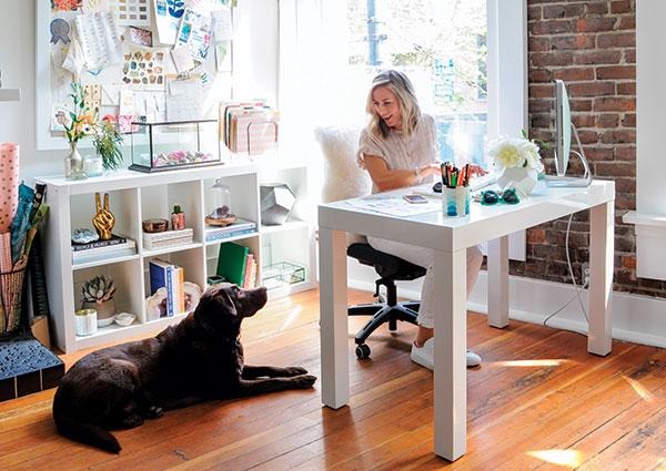 "Corner Office | Alexandra's inspiration board is ""ever-changing,"" as is her desk, which adjusts for sitting or standing"
