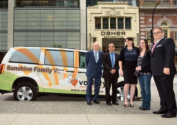 (L-R) Bob Stewart, Variety director and past president; Bill Senghera, Variety past president; Kristy Gill, Variety executive director; Danielle Brisebois (Sunshine Family Van recipient); Howard Blank, Variety president