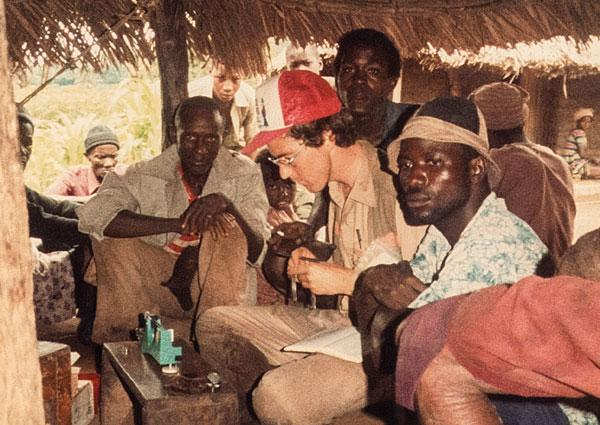 Beaty weighs alluvial gold from sampling a project in Sierra Leone, 1984