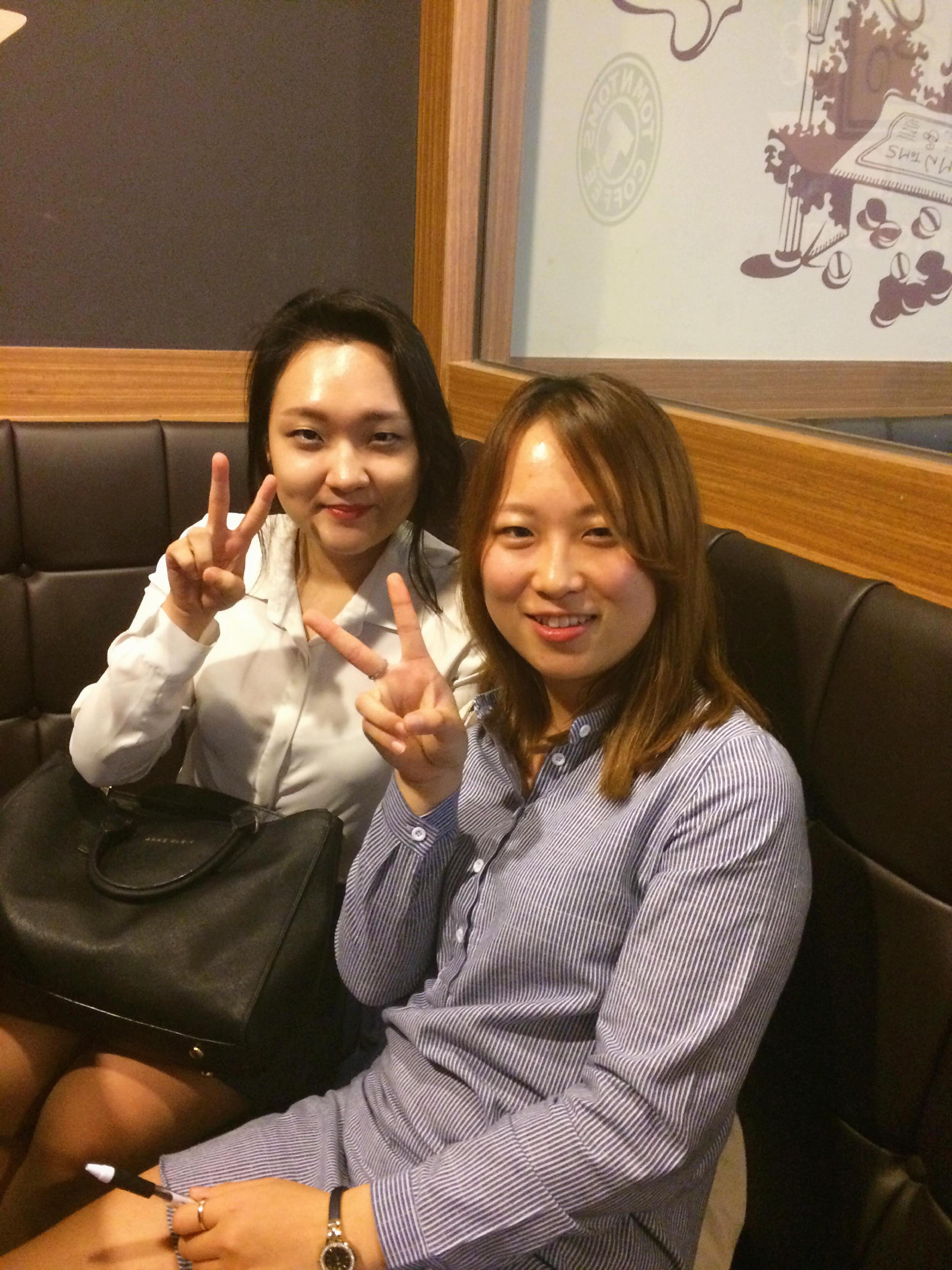 interview two korean girls peace sign