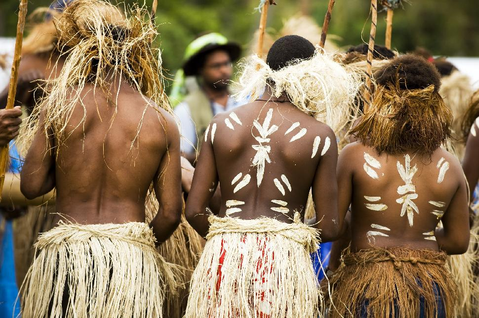 New Caledonia local tradition culture people men paint