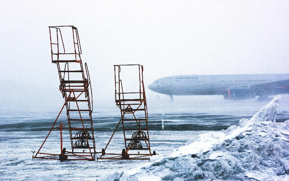 snowy airport ice plane winter weather
