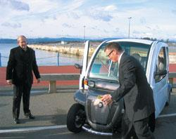 Who pulled the plug? Transportation Minister Kevin Falcon (R) with ElectricCarBC's Brad Ackerman and a GEM electric car.