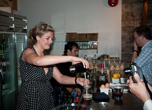 General manager Lauren Mote pours her tasty Charred Bourbon Sour.